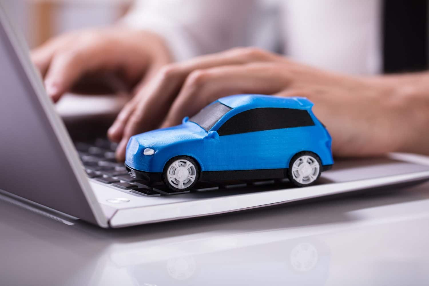 car toy on top of a laptop