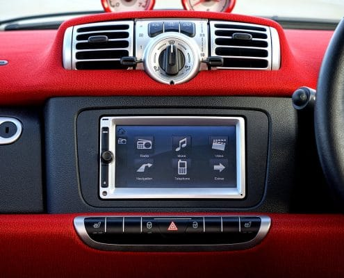 modern car dashboard with indicators like airbag light